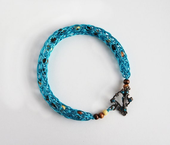 Aqua Blue woven wire bracelet with wooden beads, Viking Knit
