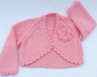 Baby sweater. Baby girl hand knitted sugar pink bolero cardigan to fit 0 to 3 months