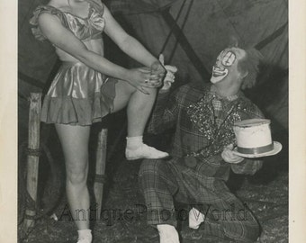 Woman acrobat circus performer with clown vintage photo