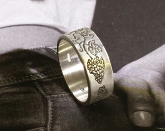 Silver ring with engraved with grapes texture