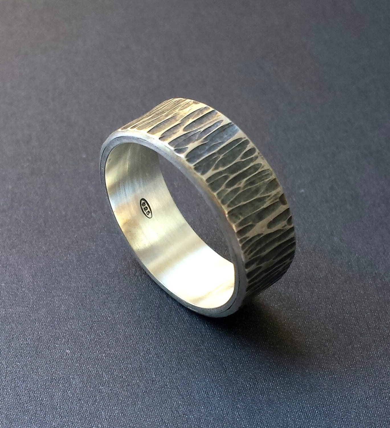 silver ring with engraved wood texture and personalized text