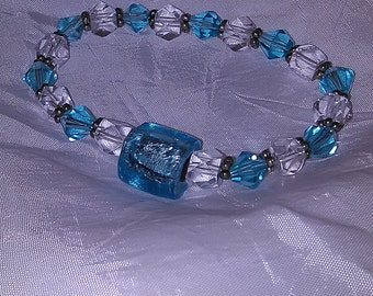 Blue, clear and white beaded bracelet