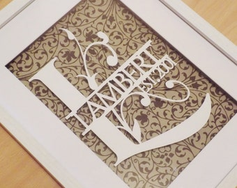 Initial and surname papercut in a shadow box frame. Makes a great wedding or valentines gift