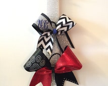 Rhinestones cheer bow holder.