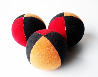 Set of 3 handmade 2.5inch juggling balls with packaging and instructions in red&orange black