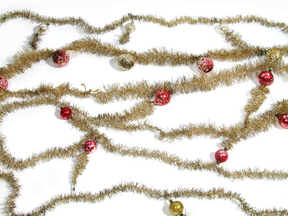 Vintage tinsel garland with ornaments feet