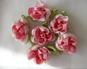Pink satin roses.   Approximately 28mm across excluding leaves.  Set of 6
