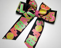 """Long Tail Softball Hair Bow- Black Long Tail Bow Sporting The Words """"SOFTBALL ROCKS' in Bright NEON Lime, Hot Pink & Yellow Touch of Glitter"""