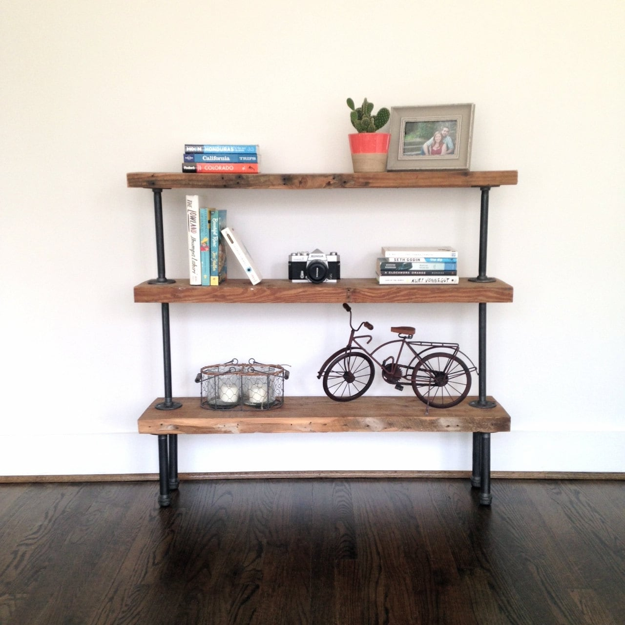 The colorado reclaimed wood pipe bookshelf for Colorado reclaimed wood