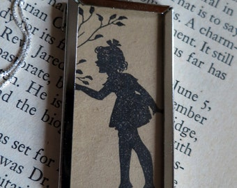 Girl Silhouette and Book Page of Poetry Two-Sided Framed Pendant