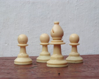 4 plastic chess pieces Pawns and Bishop - Made in USSR
