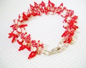 Beaded bracelet in shades of red decorated with smal leaves and flowers, handmade, chic, elegant, party, romantic, delicat,extra fine