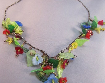 Red, yellow, blue floral lucite necklace and earrings