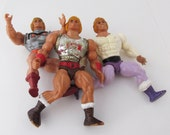 He-Man Toy Figure Lot Flying Fists He-Man, Prince Adam Battle Armor He-Man (Poor Condition)