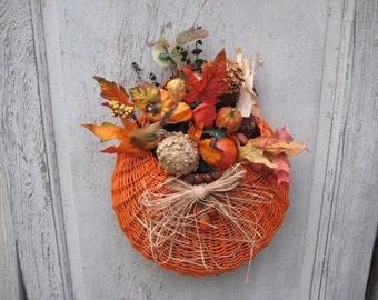 Orange basket with fall flowers, leaves, pumpkin, gourd, door decor, fall autumn decor