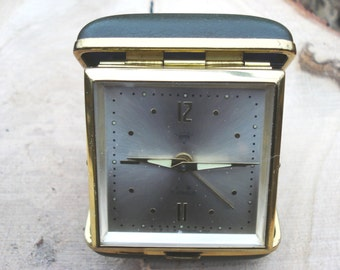 Vintage Shanghai Chinese Mechanical Folded Olive Green Leather Travel Alarm Clock /Shanghai China/Working condition,1970s