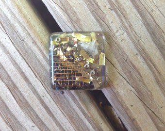 square orgonite pin with computer part