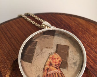 Surreal collage necklace