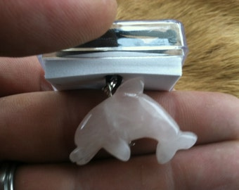 Carved stone Dolphin necklace.  Made of Rose Quartz