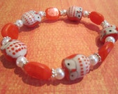 Orange Ceramic Owl Bracelet with Orange Czech Beads, Glass Pearls, and Silver-Plated Accents