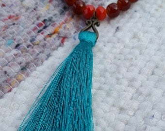 Long Tassel necklace with dark cyan tassel and turquoise stones, brown glass beads. Boho necklace.