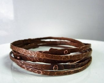 3 stackig textured copper bangles, cold connection.