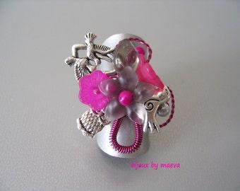 fuchsia fuchsia beaded costume jewelry ring and gray birds