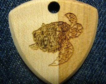 Wooden Guitar Pick with Sea Turtle engraving.