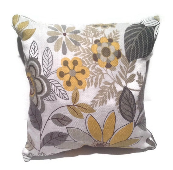 Decorative throw pillow with shades of yellow/gold and grey