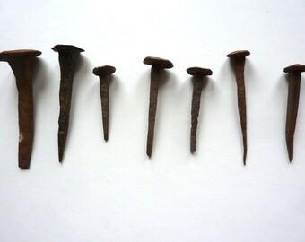 7 antique handmade nails