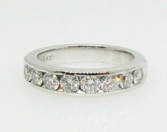 14 K white gold diamond wedding band.