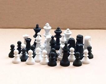 30 plastic  chess pieces
