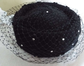 VINTAGE Ladies Hat 1950's Black wool Pill Box/Mourning hat Apllique flowers & rhinestones all round with veil  from HENRY POLLAK New York