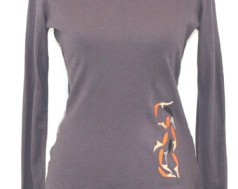 Deep purple cotton blend turtleneck sweater with chiffon hem trim. Embroidered with koi design