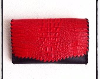 Handy bag with red crocodile print.