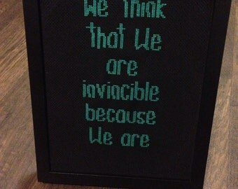 We Think We Are Invincible Because We Are. Framed cross stitch