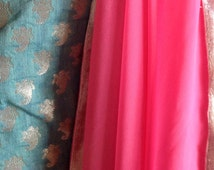 Classy rose georgette saree with white gold trim and unstitched teal brocade blouse fabric