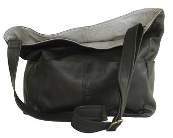 """A """"TEL AVIV"""" folded black bag. The bag is big enough to contain """"half of our household"""", as some of us like……"""