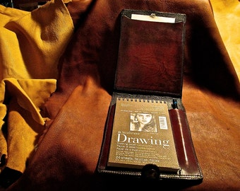 Artist's leather field sketch pad with pencil holder and refillable sketch pad.
