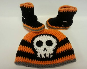 Orange, black and grey crocheted motorcycle themed boots and beanie set.