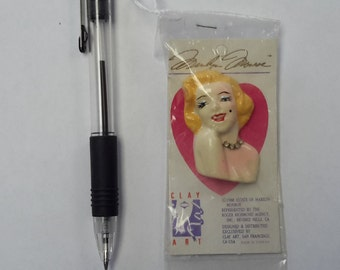 Marilyn Monroe pin or brooch from the estate of Marilyn Monroe. New in package
