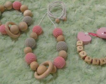 Whole necklace of portage, attached pacifier and teether rattle
