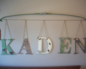 custom name hanging from a bow. baby or toddler room decor