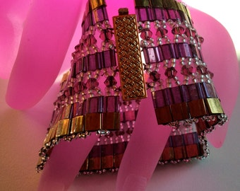Egyptian bracelet is woven by hand with with Swarovoski, Tila Beads and the Czech rock. It is simply fabulous.