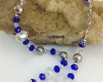 Blue and Clear Cut Crystal necklace with round pewter bead and Swarovski spacer beads.