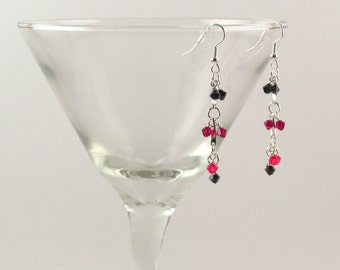 Hand-linked Swarovski crystal earrings in reds and black.