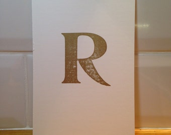 Gold ink letter R, letterpress print, unframed – 120mm x 180mm (approx)