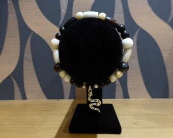Bone Bead Bracelet with Snake Charm