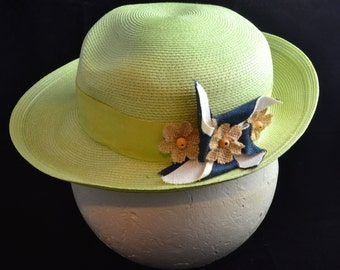 Vintage Wide-Brimmed Sinamay Hat with Silk Pinwheel Flower.