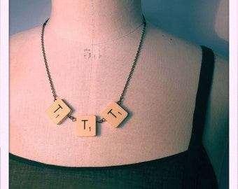 """TTT"" necklace with vintage scrabble letters. Chain and black sheer ribbon."
